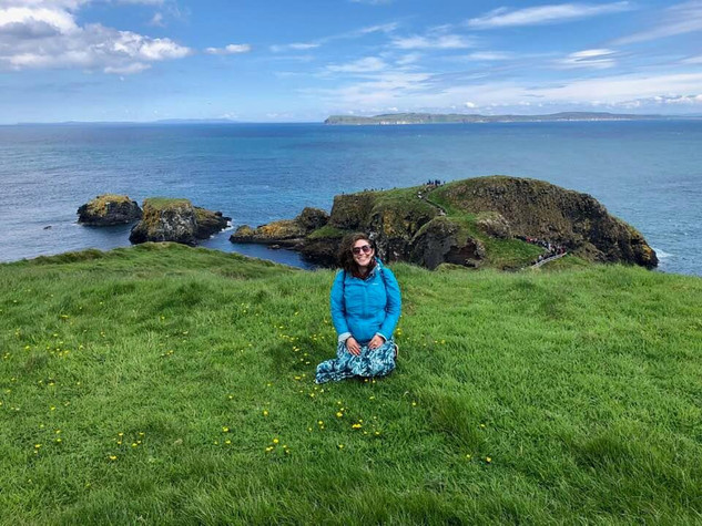 Chloe in front of Carrick-a-rede, Ireland