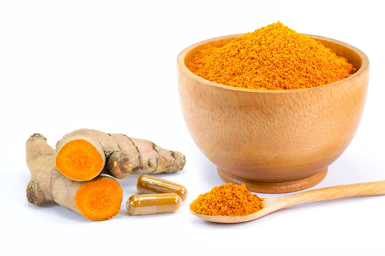 Turmeric ground in wooden bowl with curc