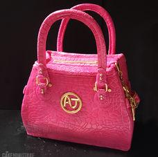 Pink handbag with gold monogram and cute bag charms