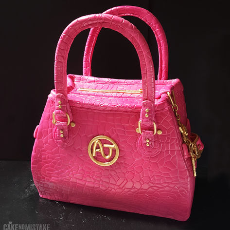 Pink handbag with gold monogram and cute bag charms