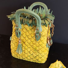 Tropical trend: The one and only pineapple handbag cake!