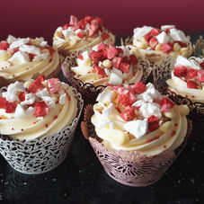 Eton Mess cupcakes filled with berry & cherry jam. Topped with strawberry, meringue & white chocolate