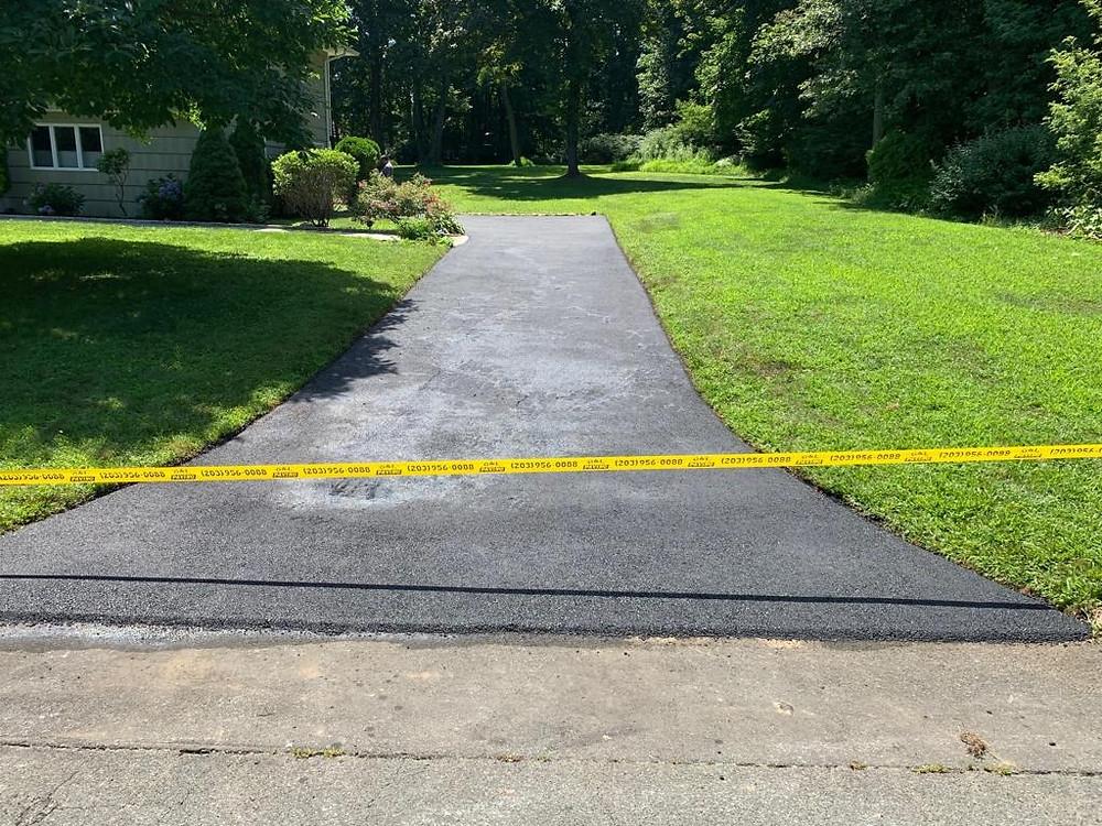 Finished, driveway, paved, asphalt, good base.