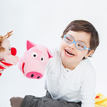 Boy with Down Syndrome playing with pupp