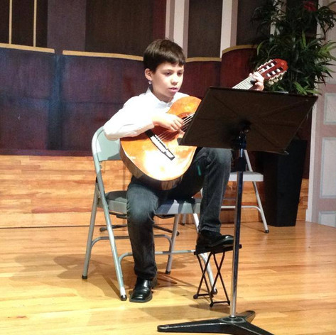 Student performing, 2014.