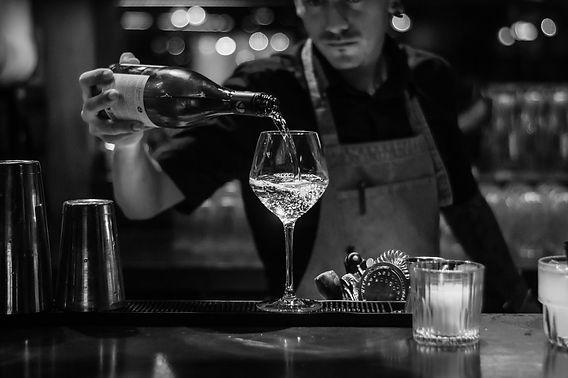 man pouring wine.jpg
