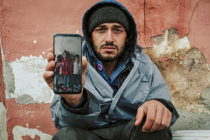Barzan, Syrian refugee and his children.