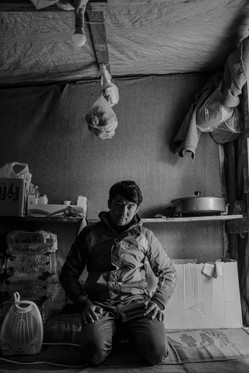 Hajrla (18), an Afghan refugee, has been living in a tent in so-called jungle with two friends for 6 months.