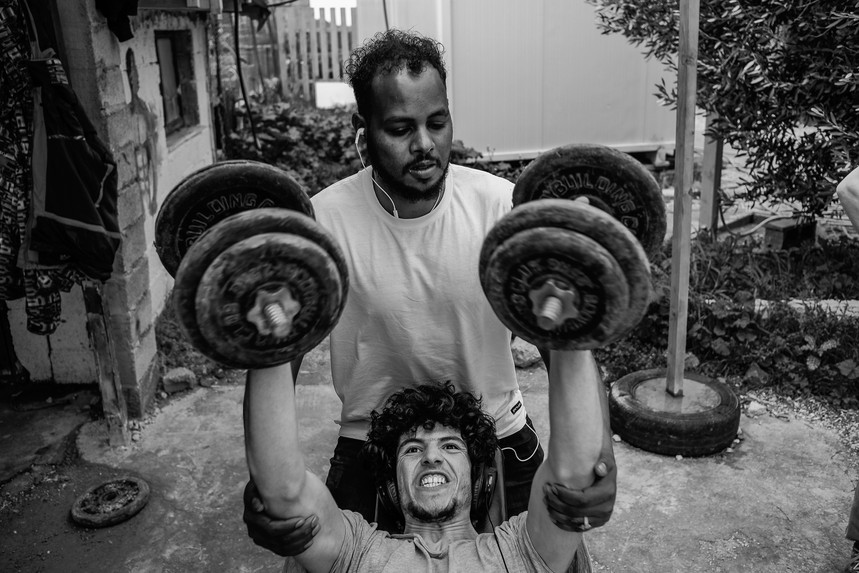 Afghan refugees from Moria camp are working out at the gym in One Happy Family Community Center in Lesvos.