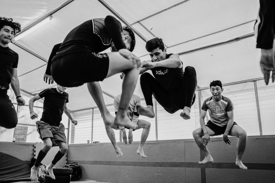 Muay Thai training in One Happy Family Community Center in Lesvos.  Guys from Afghanistan staying in the refugee camps in Lesvos need a break from the camp vegetation. Different forms of sport work well in this.