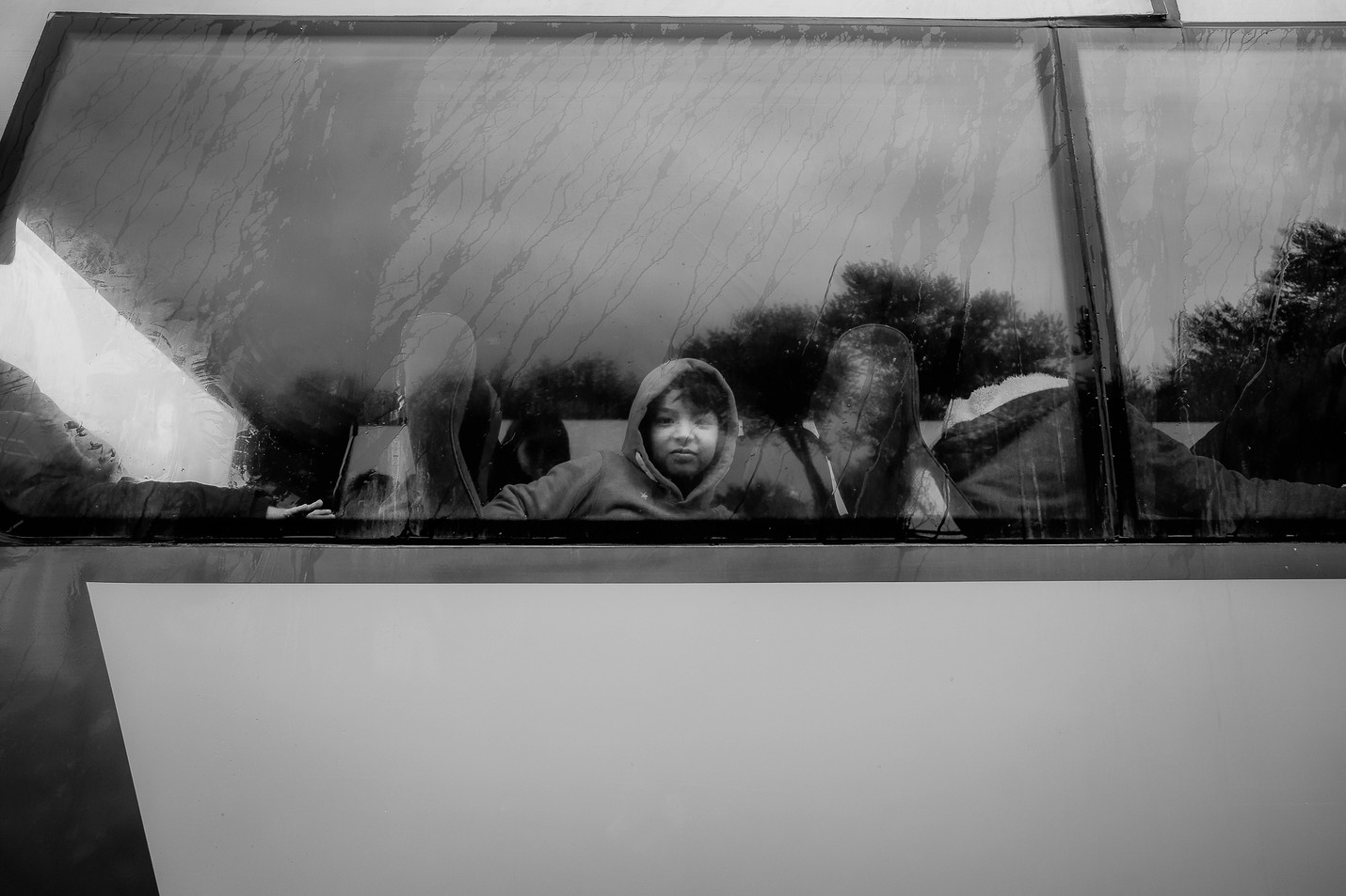 Children from Moria in a bus taking them to school.