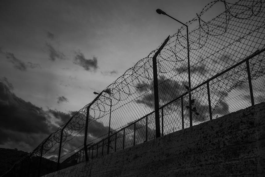 Walls and fences around the Moria refugee camp.