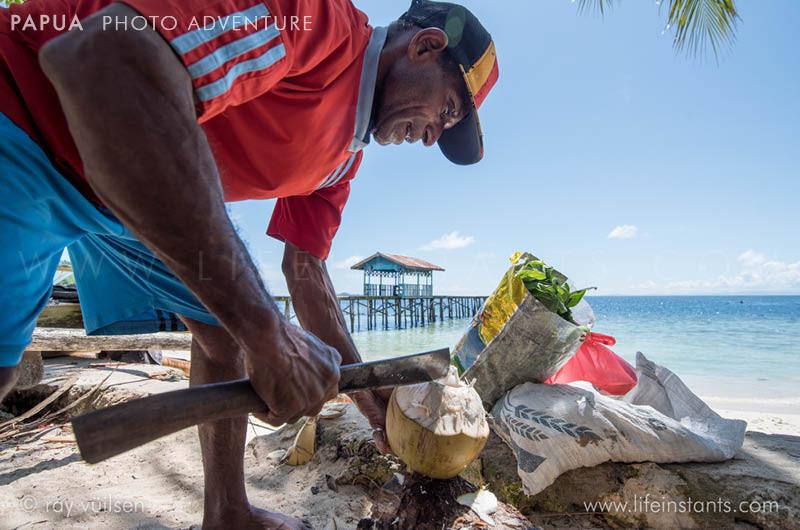 Photography Adventure Travel Papua Coconut Fisherman