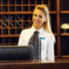 Woman and Man working at a hotel front desk
