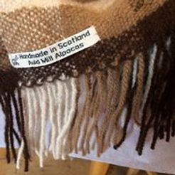 Fringe on thrw woven in Auld Mill Alpacas yarns