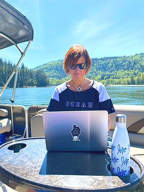 Tamara Elias from Sidekick Web Design & Writing working from a boat in Port Moody, BC