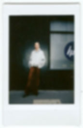 A polaroid picture of a model wearing This Is The Uniform in Soho, London