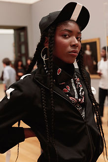 A model wearing This Is The Uniform at Tate Britain, Stance Exhibition