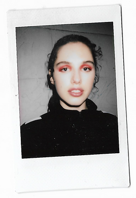 A polaroid picture of a model wearing This Is The Uniform for pop up shop event