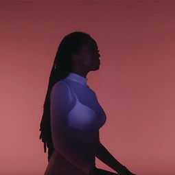 Kelela wearing This Is The Uniform White Mesh Bodysuit in A Message music video