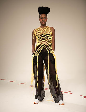 A model wearing This Is The Uniform at New York Fashion Week