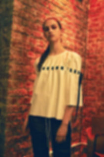 A model wearing This Is The Uniform at pop up shop opening, This Is The Shop, PVC Strap Tee