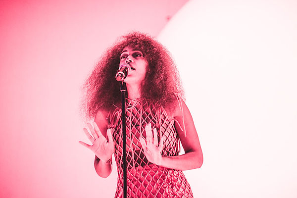 Solange Knowles Wearing The Red Rouleau Dress whilst performing at Lovebox Festival 2017