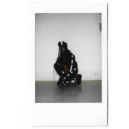 A polaroid of a model wearing This Is The Uniform at Tate Britain, Stance Exhibition