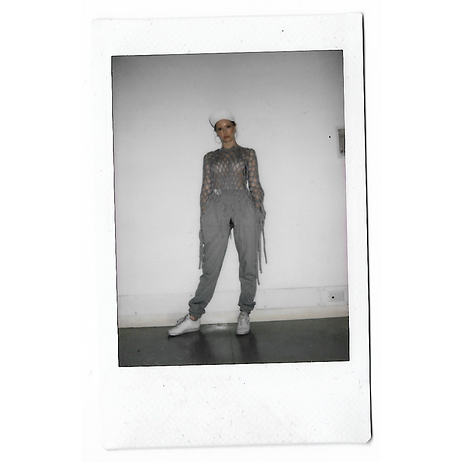 A polaroid picture of a model wearing This Is The Uniform at Tate Britain, Stance Exhibition