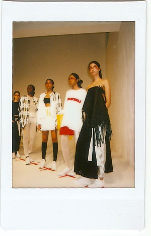 A polaroid picture of a group of models wearing This Is The Uniform at New York Fashion Weeke