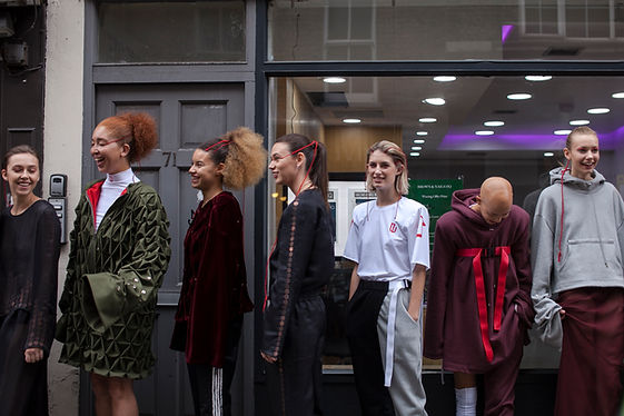 A group of models wearing This Is The Uniform in Soho, London