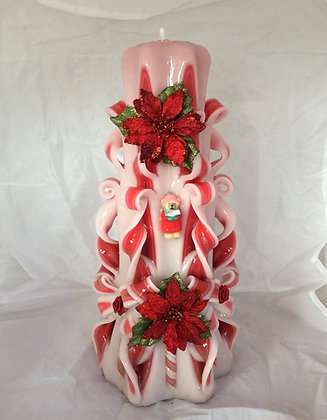Hand carved christmas candle with poinsettia