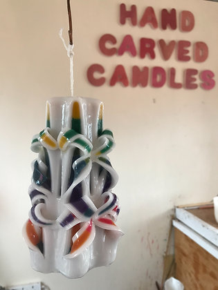 Multi coloured carved candle