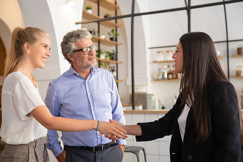 happy-confident-female-manager-meeting-with-customers-and-shaking-hands.jpg