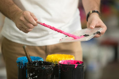 close-up-male-hands-combining-cmyk_1163-