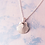 Thumbnail: Tiny Silver Scallop Necklace