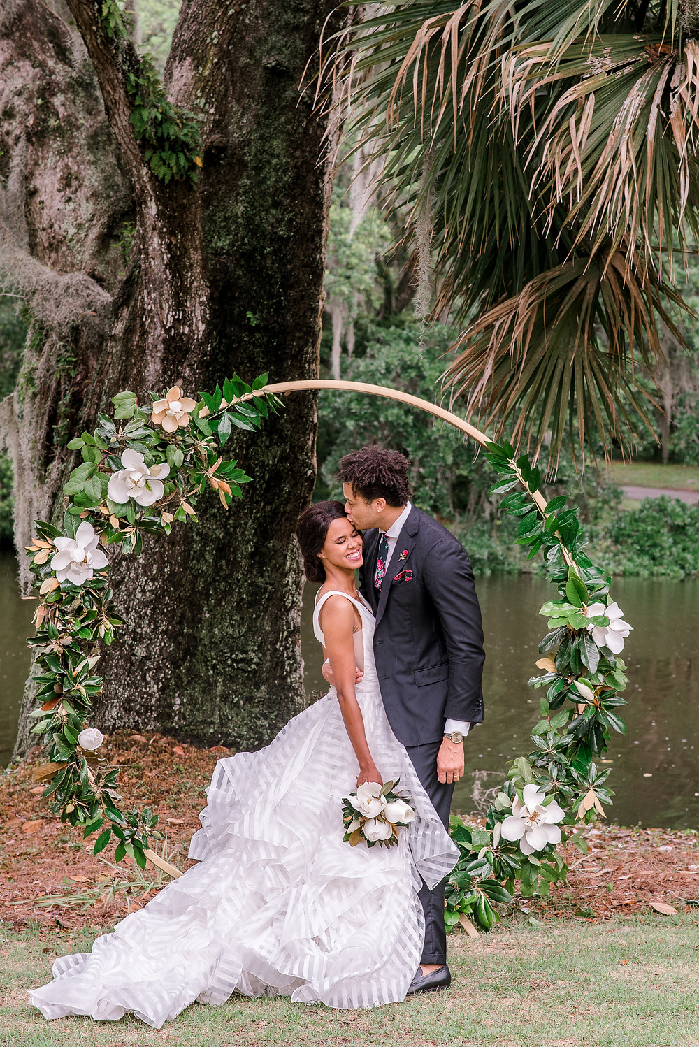 Floral arch for ceremony | Charleston photographer Nina Bashaw Photography | Columbia, SC wedding photographers | Wedding at Legare Waring House | Morilee wedding dress | Southern wedding venue