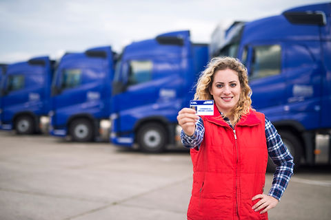 Woman truck driver proudly holding comme