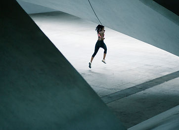 Girl Running in Urban Scenery