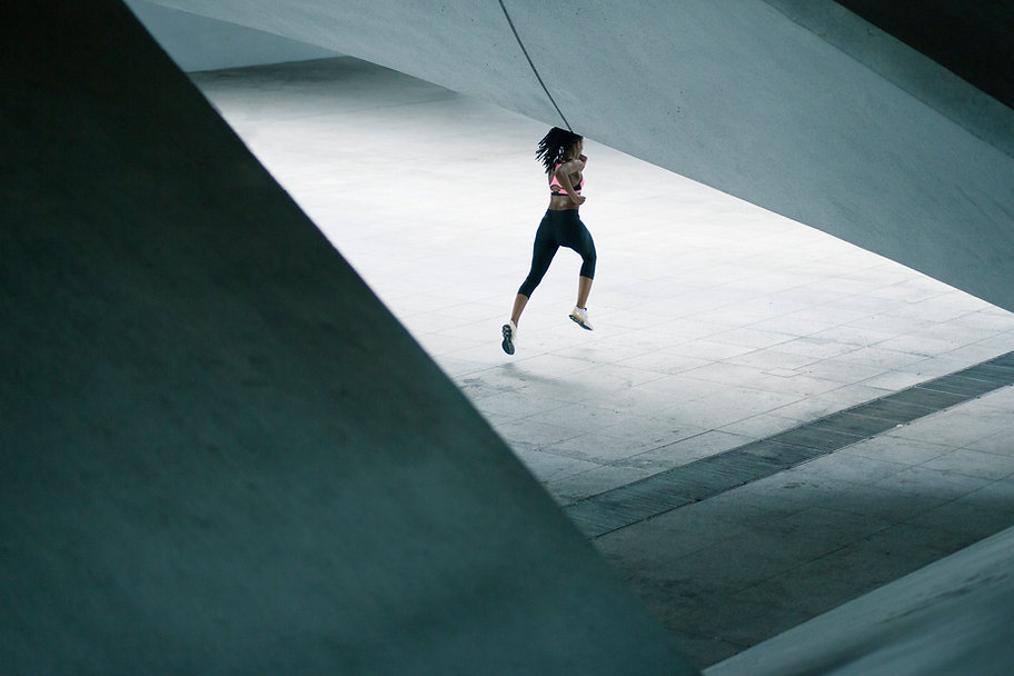 Girl Running in Urban Scenery