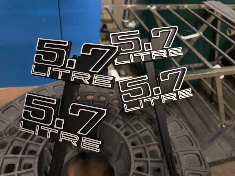Holden custom 5.7 Litre badges