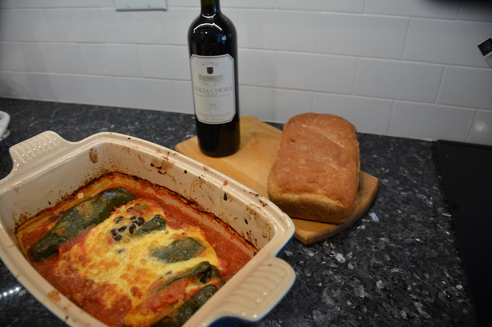 Stuffed poblanos, Greek wine and a loaf of homemade whole wheat bread.