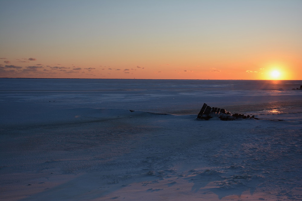 That's not the surface of Mars. That's The Great South Bay on Long Island at sunset. Frozen solid.