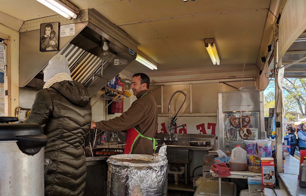 Joe Peters of Emily's Apple Puffs whips up a batch at a Sayville festival