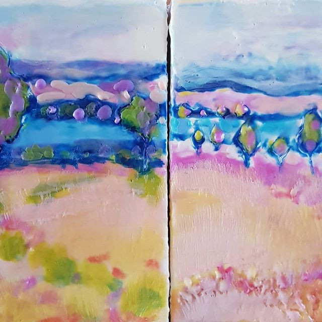 two colourful small encaustic landscapes sitting side by side