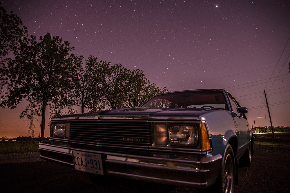 Starlight reveals this romantic interlude with a gorgeous old Chevy.