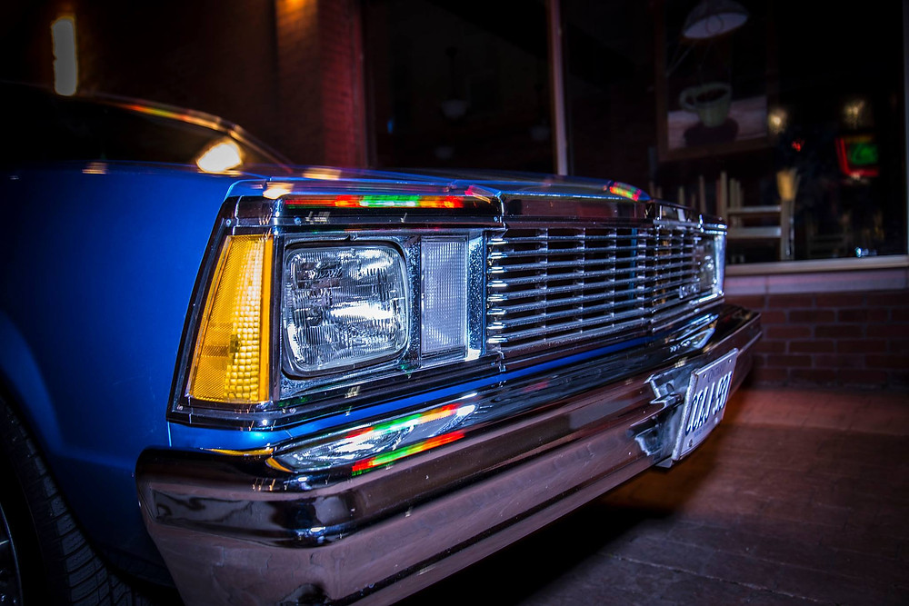 The squared off front grille of Darcy's 1981 Chevrolet Malibu.