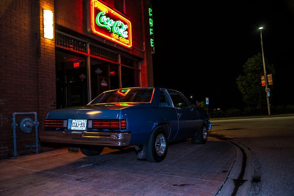Chevy Malibu under the neon lights.