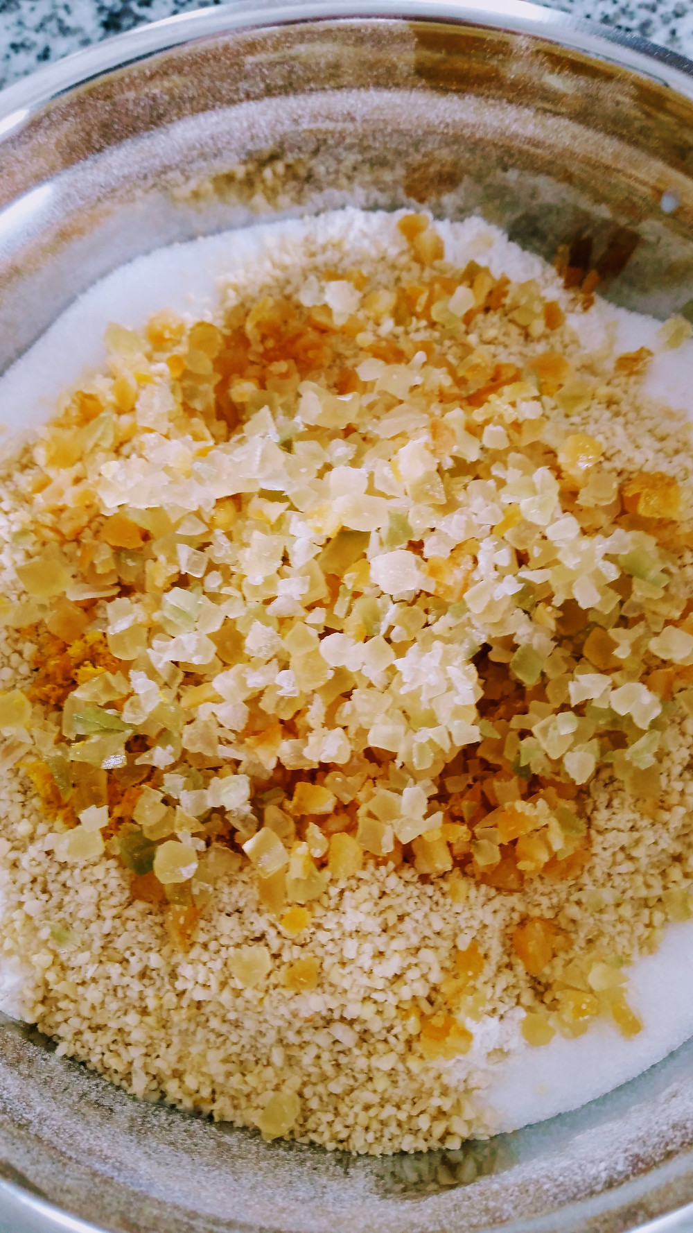 Lemon peel and almonds being added to yeast dough