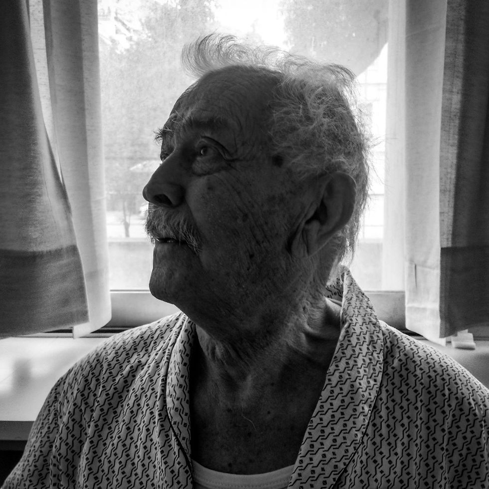 A portrait of my grandpa capturing the moment when his lovely cardiologist announced him that he can takes the discharge note from the hospital and go back to his home.  A few minutes before I made him a prank. I told him that he has to stay a couple of days more. My old man was almost completely disappointed. The doctor at first was surprised but quickly understood my motives and she didn't say anything, just making some signs with her head showing to my pap's that his grandson was right! Finally, while we were leaving from the hospital, my grandfather, replied to the prank I did to him. He approaches the doctor with sneaky way and told her with style, that his grandson is a very good guy and unmarried to...! He paid me back with my own coin...!hahaha I know that he hates hospitals and he knows that I hate matchmakings! The score 1-1 final! Cheers 🍻⚽ 93 years of history and we keep on going! Love you pap's!